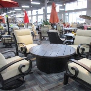 four chairs around round firepit table
